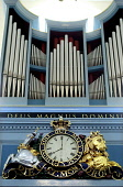 A DETAIL OF THE CLOCK AND ORGAN IN THE CANONGATE CHURCH- DATING FROM 1688 WHEN IT WAS BUILT BY JAMES SMITH TO ACCOMMODATE THE EJECTED PARISHONERS FROM HOLYROOD'S CHAPEL ROYAL, JUST OFF THE ROYAL MILE,... Public, NMR INTERIOR,TIME,RELIGION,PIPES,ORNATE