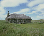A traditional stone black house with thatched roof, used for self catering at Borve near Scarista on the Island of Harris, Outer Hebrides.   Pic: Ian Macrae Young / Scottish Viewpoint Tel: +44 (0) 131... croft,crofting,summer,accommodation,heritage,western isles,isle