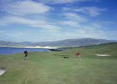 A golfer enjoys a game at Scarista on the links golf course on the island of Harris, Outer Hebrides. Visitors are asked to pay at an honesty box and then enjoy spectacular views of the Atlantic beache... ISLE,GOLF,BEACH,COAST,COASTAL,SUMMER,SUNNY,WESTERN ISLES