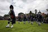 Piping band marching at The Island of Skye Highland Games, Portree, Inner Hebrides. Pic: Marcus McAdam / Scottish Viewpoint Tel: 0044 (0) 131 622 7174 Fax:0044 (0) 131 622 7175 E-Mail: info@scottishvi... Public, NMR Attraction,Bag Pipes,Bagpipes,Cultural,Heritage,Highland Games,Highlands,Isle of Skye,Kilt,Marching,Music,Pipers,Piping Band,Portree,Scotland,Tourism,Tradition,Traditional,ISLAND,PEOPLE