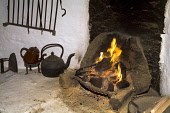 Shetland croft house museum SOUTHVOE SHETLAND Farmhouse fireplace kettle pots peat fire burning  Pic: Doug Houghton / Scottish Viewpoint Tel: 0044 (0) 131 622 7174 Fax: 0044 (0) 131 622 7175 E-Mail: i... Public, NMR croft,house,museum,farmhouse,fireplace,kettle,fire,scotland,scottish,farming,history,farm,open,hearth,place,drying,food,produce,preserve,homestead,dwelling,abode,inside,traditional,rural,agricultural,