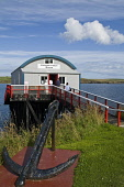 Brims HOY ORKNEY Longhope Lifeboat museum shed people entering  Pic: Doug Houghton / Scottish Viewpoint Tel: 0044 (0) 131 622 7174 Fax: 0044 (0) 131 622 7175 E-Mail: info@scottishviewpoint.com Web: ww... Public, NMR orkney,hoy,brims,tourists,rnli,lifeboat,museum,travel,tourism,vacation,break,holidaymakers,makers,visitors,coast,inshore,sea,royal,national,institution,uk,britain,british,gb,building,exterior,outside,