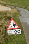 Roadsign ROAD TRANSPORT Lose chippings warning sign 20 mph max speed  Pic: Doug Houghton / Scottish Viewpoint Tel: 0044 (0) 131 622 7174 Fax: 0044 (0) 131 622 7175 E-Mail: info@scottishviewpoint.com W... Public, NMR transport,road,roadsign,roadside,traffic,signage,countrylane,red,triangle,regulations,scotland,scottish,highlands,uk,britain,british,gb,lane,narrow,side,roadway,sign,restricts,restricted,restrictive,r