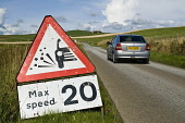 Roadsign ROAD TRANSPORT Lose chippings warning sign 20 mph max speed car on road  Pic: Doug Houghton / Scottish Viewpoint Tel: 0044 (0) 131 622 7174 Fax: 0044 (0) 131 622 7175 E-Mail: info@scottishvie... Public, NMR transport,road,roadsign,signage,traffic,roadside,sign,post,signpost,red,triangle,regulations,scotland,scottish,highlands,uk,britain,british,gb,lane,narrow,countrylane,side,roadway,car,motor,motorcar,a