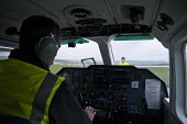 Kirkwall airport KIRKWALL ORKNEY Britten Norman BN-2B-26 Islander airplane pilot cockpit and display panel  Pic: Doug Houghton / Scottish Viewpoint Tel: 0044 (0) 131 622 7174 Fax: 0044 (0) 131 622 717... Public, NMR orkney,islander,airplane,pilot,cockpit,display,northern,isles,islands,outer,isle,island,britten,norman,panel,kirkwall,airport,people,airliner,aircraft,aeroplane,plane,airpilot,aeronaut,aviator,flyer,f