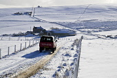 ROADS TRANSPORT Farmers truck driving icy snowy roads snow fields farmhouses Orkney  Pic: Doug Houghton / Scottish Viewpoint Tel: 0044 (0) 131 622 7174 Fax: 0044 (0) 131 622 7175 E-Mail: info@scottish... Public, NMR transport,driving,truck,snowy,roads,snow,weather,icy,chilly,freezing,snowscape,scape,white,cover,season,winter,time,wintery,wintertime,farming,agricultural,agriculture,rural,economy,rustic,motor,drive