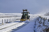 ROADS TRANSPORT Farm tractor snowplough clearing snow Orkney country roads  Pic: Doug Houghton / Scottish Viewpoint Tel: 0044 (0) 131 622 7174 Fax: 0044 (0) 131 622 7175 E-Mail: info@scottishviewpoint... Public, NMR roads,tractor,snowplow,snow,plow,winter,vehicle,weather,snowy,icy,chilly,freezing,season,time,wintery,wintertime,farm,machinery,agricultural,tractors,machines,vehicles,machine,motor,drive,drives,drivi