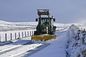 ROADS TRANSPORT Farm tractor snowplough clearing snow Orkney country roads  Pic: Doug Houghton / Scottish Viewpoint Tel: 0044 (0) 131 622 7174 Fax: 0044 (0) 131 622 7175 E-Mail: info@scottishviewpoint... Public, NMR tractor,snowplough,clearing,roads,snow,plough,road,weather,snowy,icy,chilly,freezing,season,winter,time,wintery,wintertime,farm,machinery,agricultural,machine,vehicle,tractors,machines,vehicles,motor,