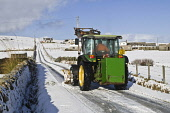 ROADS TRANSPORT Farm tractor snowplough clearing snow Orkney country roads  Pic: Doug Houghton / Scottish Viewpoint Tel: 0044 (0) 131 622 7174 Fax: 0044 (0) 131 622 7175 E-Mail: info@scottishviewpoint... Public, NMR roads,tractor,snowplough,rural,snow,plough,orkney,uk,weather,snowy,icy,chilly,freezing,season,winter,time,wintery,wintertime,farm,machinery,agricultural,machine,vehicle,motor,drive,drives,driving,lane