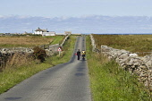 NORTH RONALDSAY ORKNEY Tourist couple walking down road airplane warning signpost North Ronaldsay  Pic: Doug Houghton / Scottish Viewpoint Tel: 0044 (0) 131 622 7174 Fax: 0044 (0) 131 622 7175 E-Mail:... Public, NMR airplane,warning,signpost,tourist,north,ronaldsay,couple,walking,down,road,holidaymakers,holiday,makers,visitors,travel,people,tourists,visitor,walk,wanders,strolling,leisure,walks,walkers,foot,2,pair