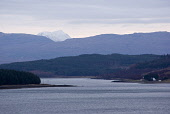 Snowy Beinn Sgritheall (a Munro) seen down Caolas Scalpay (the narrows of Scalpay) on the east coast of the Hebridean island of Skye, Scotland. Island of Scalpay is on the left.  PIC: Ruaridh Pringle... Public, NMR hill,mountain,water,hebrides,snow