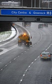 Gritter treats the Icy M8 motorway, Glasgow Pic: Garry F McHarg / Scottish Viewpoint Tel: +44 (0) 131 622 7174 Fax: +44 (0) 131 622 7176 E-Mail: info@scottishviewpoint.com Web: www.scottishviewpoint.c... Public, NMR winter,gritting,weather,bad,travel,road,roads,grit,salt