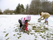Two children enjoy the snow by beginning to build a snowman ay Crowood near Glasgow  Pic: Garry F McHarg / Scottish Viewpoint Tel: +44 (0) 131 622 7174 Fax: +44 (0) 131 622 7176 E-Mail: info@scottishv... Public, MR winter,weather,bad,snow,fun,play,snowman,youngsters,young,child,girls