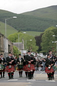 Innerleithen Pipe Band Competition 2009 - Bands walking down the High Street at the end of the day's competition, Innerleithen, Scottish Borders.  Pic: Jason Baxter / Scottish Viewpoint Tel: +44 (0) 1... Public, NMR innerleithen,borders,scotland,event,piper,bagpipes,drum,drummers,perform,music,culture,cultural,loud,competition,st ronan piping society,march,marching,entertain,entertaining,pastime,hobby,kilt,kilts,