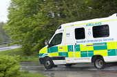 Scottish Ambulance Service bad weather on the A75 road ambulance responding to a emergency call approaching junction at speed in heavy rain UK  Picture Credit: Allan Devlin / Scottish Viewpoint Tel: +... Public, NMR traffic,road,a75,dumfries,and,galloway,scotland,transport,transportation,vehicle,scottish,ambulance,service,rain,bad,weather,wet,pouring,emergency,call,out,speed,dangerous,brake,skid