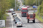A75 road busy roundabout near Dumfries UK agricultural vehicle tractor with articulated lorry behind  Picture Credit: Allan Devlin / Scottish Viewpoint Tel: +44 (0) 131 622 7174 Fax: +44 (0) 131 622 7... Public, NMR traffic,road,a75,dumfries,and,galloway,scotland,transport,transportation,vehicle,articulated,lorry,tractor,agricultural,farm,farming,roundabout,busy