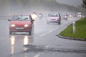 Dual carriageway road A75 near Dumfries Scotland UK bad weather rain mist spray motorcycles overtaking a line of cars  Picture Credit: Allan Devlin / Scottish Viewpoint Tel: +44 (0) 131 622 7174 Fax:... Public, NMR traffic,dual,carriageway,road,lights,dark,wet,mist,misty,spray,heavy,rain,travel,travelling,to work,poor,visibility,bad,weather,car,motorcycle,motorbike,overtaking,passing,line,busy