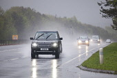 Dual carriageway road A75 near Dumfries Scotland UK bad weather rain mist spray   Picture Credit: Allan Devlin / Scottish Viewpoint Tel: +44 (0) 131 622 7174 Fax: +44 (0) 131 622 7175 E-Mail: info@sco... Public, NMR traffic,dual,carriageway,road,lights,dark,wet,mist,misty,spray,heavy,rain,travel,travelling,to work,poor,visibility,bad,weather,car,landrover,morning,rush,hour,rangerover