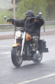 Dual carriageway road A75 near Dumfries Scotland UK bad weather rain mist spray a wet motorcyclist on a chopper motorbike heading for the North West 200 motorbike racing in Ireland  Picture Credit: Al... Public, NMR traffic,dual,carriageway,road,lights,dark,wet,mist,misty,spray,rain,travel,travelling,to work,poor,visibility,bad,weather,motorbike,motorcycle,motorcyclist,skull,chopper,north,west,200,miserable