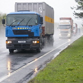 A busy dual carriageway road A75 near Dumfries Scotland UK bad weather rain mist spray line of lorries with lights on  Picture Credit: Allan Devlin / Scottish Viewpoint Tel: +44 (0) 131 622 7174 Fax:... Public, NMR traffic,dual,carriageway,road,lights,dark,wet,mist,misty,spray,rain,travel,travelling,to work,poor,visibility,bad,weather,lorry,lorries,line,busy,rush,hour,morning