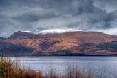 Dramatic light catching the summit of Ben Lomond, viewed across Loch Lomond. Picture Credit: Peter Chisholm / Scottish Viewpoint Tel: +44 (0) 131 622 7174 Fax: +44 (0) 131 622 7175 E-Mail: info@scotti... Public, NMR national,park,loch,scotland,scottish,winter,snow,mountain,summit,peak,hillwalking,hiking,trekking,munro,dramatic,landscape