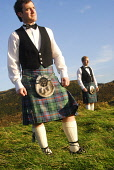 Traditional Highland dress. Picture Credit: Chris Robson / Scottish Viewpoint Tel: +44 (0) 131 622 7174 Fax: +44 (0) 131 622 7175 E-Mail: info@scottishviewpoint.com Web: www.scottishviewpoint.com This... Public, MR tartan,material,kilt,sporran,sporrans,pin,vest,waistcoat,scotsman,clothing,clothes