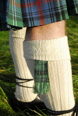 Traditional Highland dress - detail of the sock garter. Picture Credit: Chris Robson / Scottish Viewpoint Tel: +44 (0) 131 622 7174 Fax: +44 (0) 131 622 7175 E-Mail: info@scottishviewpoint.com Web: ww... Public tartan,material,kilt,scotsman,clothing,clothes