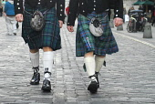 Traditional Highland dress - two Scotsmen walk up the Royal Mile in the city centre of Edinburgh.Picture Credit: Chris Robson / Scottish ViewpointTel: +44 (0) 131 622 7174Fax: +44 (0) 131 622 7175E-Ma... Public tartan,material,kilt,prince charlie jacket,scotsman,cobbles,old town,sporran,sporrans,clothing,clothes, kilts, men, man, people