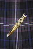 A sgian dubh. Picture Credit: Chris Robson / Scottish Viewpoint Tel: +44 (0) 131 622 7174 Fax: +44 (0) 131 622 7175 E-Mail: info@scottishviewpoint.com Web: www.scottishviewpoint.com This picture canno... Public interior,tartan,kilt,bowdens,skene,dhu,skean,ceremonial knife,clothing,clothes