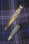 A sgian dubh. Picture Credit: Chris Robson / Scottish Viewpoint Tel: +44 (0) 131 622 7174 Fax: +44 (0) 131 622 7175 E-Mail: info@scottishviewpoint.com Web: www.scottishviewpoint.com This picture canno... Public interior,tartan,kilt,bowdens,skene,dhu,skean,scabbard,ceremonial knife,clothing,clothes