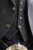 A detail of a tweed jacket and waistcoast worn with a kilt. Picture Credit: Chris Robson / Scottish Viewpoint Tel: +44 (0) 131 622 7174 Fax: +44 (0) 131 622 7175 E-Mail: info@scottishviewpoint.com Web... Public interior,bowdens,horn,button,buttons,silk tie,sporran,clothing,clothes