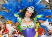 A performer ate the Mardi Gras carnival at the beginning of the Edinburgh Jazz and Blues Festival in the city centre of Edinburgh. Picture Credit: Simon Williams / Scottish Viewpoint Tel: +44 (0) 131... Public, NMR attraction,summer,smile,event,costume
