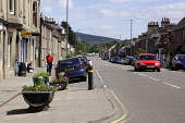 The main street through Aberlour, Speyside, Moray. Picture Credit: Iain McLean / Scottish Viewpoint Tel: +44 (0) 131 622 7174 Fax: +44 (0) 131 622 7175 E-Mail: info@scottishviewpoint.com Web: www.scot... Public, MR summer,sunny,charlestown,flowers,road,people,cars