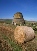 Dovecot RENDALL ORKNEY Bee hive type Dovecot building and hay bale  Picture Credit: Doug Houghton / Scottish Viewpoint Tel: +44 (0) 131 622 7174   Fax: +44 (0) 131 622 7175 E-Mail : info@scottishviewp... Public dovecot,dovecote,bee,hive,type,hay,bale,harvest,uk,cut,scotland,scottish,dove,doo,cot,doocot,cote,pigeon,coop,house,nest,farm,reap,gathering,harvesting,building,architecture,construction,heritage,trad