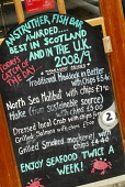 The chalkboard menu outside the Anstruther Fish Bar, Anstruther, East Neuk of Fife. Picture Credit: Chris Robson / Scottish Viewpoint Tel: +44 (0) 131 622 7174 Fax: +44 (0) 131 622 7175 E-Mail: info@s... Public 2010,summer,food,eating,famous,award,winning,renowned,cafe,restaurant,fish n chips,chalk board,information,prices