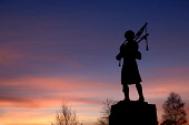 The statue of a piper silhouetted against the sunset at the entrance to the House of Bruar visitor centre, Blair Atholl. Perthshire.  Picture Credit: Ross Graham / Scottish Viewpoint Tel: +44 (0) 131... Public silhouette,musician,heritage,historic,traditional,music,bagpipes,winter