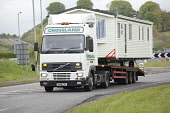 Traffic on the A75 wide or abnormal load static caravan on the back of a articulated lorry, Dumfries and Galloway. Picture Credit: Allan Devlin / Scottish Viewpoint Tel: +44 (0) 131 622 7174   Fax: +4... Public road,a75,traffic,uk,dumfries,and,galloway,scotland,wide,load,abnormal,articulated,lorry,static,caravan,transport,transportation