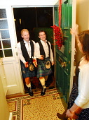 First footing on Hogmanay.Picture Credit: Chris Robson / Scottish ViewpointTel: +44 (0) 131 622 7174  Fax: +44 (0) 131 622 7175E-Mail : info@scottishviewpoint.comWeb: www.scottishviewpoint.comThis pho... Public, MR 2010,new,year,years,eve,scotland,tartan,kilt,highland dress,gift,coal,whisky,shortbread,tall,dark,handsome,celebrate,event,january,winter,1st,kilts, people, men, boys, boy, happy, tradition, tradition