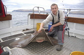 Skate Angler with Skate, Oban Picture Credit: Scott Whitelaw / Scottish Viewpoint Tel: +44 (0) 131 622 7174   Fax: +44 (0) 131 622 7175 E-Mail : info@scottishviewpoint.com Web: www.scottishviewpoint.c... Public, MR summer,fishing,angling,fisherman,fishermen,angler,anglers,fish,rod,rods