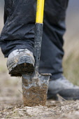Close up of foot and spade during tree-planting session, Scotland.  Picture Credit: Peter Cairns / Scottish Viewpoint Tel: +44 (0) 131 622 7174   Fax: +44 (0) 131 622 7175 E-Mail : info@scottishviewpo... Public, NMR Glen Moriston,Highlands,June,Peter Cairns,Scotland,Trees for Life,charity,cold,conservation,dirty,ecology,enjoyment,experience,forest,habitat restoration,hand,hard,healthy,human,man,manual,muddy,nativ