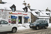Motor car driving outside snowy rural village shop covered in snow, Carrbridge, Highland. Picture Credit: D. Houghton / Scottish Viewpoint Tel: +44 (0) 131 622 7174   Fax: +44 (0) 131 622 7175 E-Mail... Public snowy,rural,village,shop,carrbridge,winter,weather,scottish,highland,highlands,scotland,cold,motor,car,driving,outside,covered,in,snow,invernessshire,frost,wintery,frosty,cover,white,time,season,winte