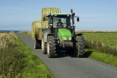 Deutz Fahr tractor hauling cyclinder bales  FARMING ORKNEY  Picture Credit: D. Houghton / Scottish Viewpoint Tel: +44 (0) 131 622 7174   Fax: +44 (0) 131 622 7175 E-Mail : info@scottishviewpoint.com T... Public deutz,fahr,tractor,carrying,bales,road,trailer,uk,hauling,cyclinder,farming,orkney,farm,tractors,machine,vehicle,machines,vehicles,farms,carry,carries,haul,hauls,harvests,harvestime,time,hay,islands,i
