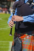 Oban, Highland Games, Argyll,  Scotland, August, 2010  Picture Credit: D. Barnes /Scottish Viewpoint Tel: +44 (0) 131 622 7174   Fax: +44 (0) 131 622 7175 E-Mail : info@scottishviewpoint.com This phot... Public Vertical,Piper,Piping,bagpipes,competition,Oban,Highland,Games,Argyllshire,Gathering,contest,sunny,tradition,traditional,historic,cultural,Scotland,UK,United,Kingdom,tourist,Attraction,Tourism,Visitor