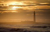 Barns Ness Lighthouse, East Lothian. Picture Credit : Andy Bennetts / Scottish Viewpoint  Tel: +44 (0) 131 622 7174  Fax: +44 (0) 131 622 7175  E-Mail : info@scottishviewpoint.com  This photograph can... Public Majestic,Tranquil Scene,Nature,Horizontal,Outdoors,Sun,Cloud,Summer,Horizon,Sunset,Dusk,Sea,Scenics,Beauty In Nature,No People,Photography,Lighthouse,Silhouette,Waves,Surf.