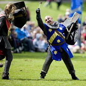 Hand fighting at a medieval event at Linlithgow Palce, West Lothian. Picture Credit : Andy Bennetts / Scottish Viewpoint  Tel: +44 (0) 131 622 7174  Fax: +44 (0) 131 622 7175  E-Mail : info@scottishvi... Public Fantasy,History,Horizontal,Outdoors,Rural Scene,Fancy Dress Costume,Front View,Action,Combative Sport,Competitive Sport,Traditional Culture,Typically English,Day,Traditional Clothing,One Person,Adult,