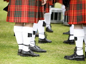 A Pipe band competition, North Berwick, East Lothian. Picture Credit : Andy Bennetts / Scottish Viewpoint  Tel: +44 (0) 131 622 7174  Fax: +44 (0) 131 622 7175  E-Mail : info@scottishviewpoint.com  Th... Public People,Performance,Teamwork,Co-operation,Togetherness,Uniform,Horizontal,Outdoors,Low Section,Mid Section,UK,Scotland,Marching Band,Bagpipes,Typically Scottish,Day,Highland Region,Tartan,Kilt,Kilts,Hi