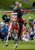 Jousting at a medieval event at Linlithgow Palce, West Lothian. Picture Credit : Andy Bennetts / Scottish Viewpoint  Tel: +44 (0) 131 622 7174  Fax: +44 (0) 131 622 7175  E-Mail : info@scottishviewpoi... Public Fantasy,History,Vertical,Full Length,Outdoors,Rural Scene,Fancy Dress Costume,Front View,Combative Sport,Competitive Sport,Animal,Approaching,Horse,Traditional Culture,Typically Scottish,Day,Tradition