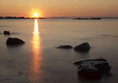 North Berwick sunset, East Lothian. Picture Credit : Andy Bennetts / Scottish Viewpoint  Tel: +44 (0) 131 622 7174  Fax: +44 (0) 131 622 7175  E-Mail : info@scottishviewpoint.com  This photograph cann... Public Travel Destinations,Horizontal,Outdoors,Clear sky,Orange,Rocks,Sunset,Sea,Beach,North Berwick,Scenics,Colour,No People,Photography,Horizon Over Water,Tranquility,Sun,Reflection.