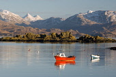 A small boat on the Sound of Sleat at Armadale, Isle of Skye, Inner Hebrides with the mountains of Knoydart in the distance. Picture Credit: Ross Graham / Scottish Viewpoint  Tel: +44 (0) 131 622 7174... Public winter,snow,capped,mountains,atmospheric,mountain,island,sunny,highland,highlands,fishing,water,coast,coastal,reflection calm