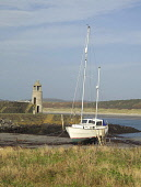 Moored boat Port Logan, Rhinns of Galloway, Dumfries and Galloway. Picture Credit: Allan Wright / Scottish Viewpoint Tel: +44 (0) 131 622 7174   Fax: +44 (0) 131 622 7175 E-Mail : info@scottishviewpoi... Public blue sky,boat,dry,dumfies and galloway,Dumfries & Galloway,dyke,field,Galloway,grass,hills,lighthouse,machars,moorings,pasture,rocks,rope,sail mast,sand,scotland,sea,stones,wigtownshire